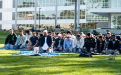 Imam Amir Abdul Malik leads the attendees in the closing prayer of Jummah Under the Sun Friday, Nov. 15, 2013. Photo by Benjamin Kamps / Xpress