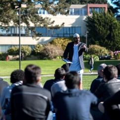 Imam Amir Abdul Malik, associated with the Masjid Al Islam mosque in Oakland, an SF State graduate, does the sermon during Jummah Under the Sun out on the quad Friday, Nov. 15, 2013. Photo by Benjamin Kamps / Xpress